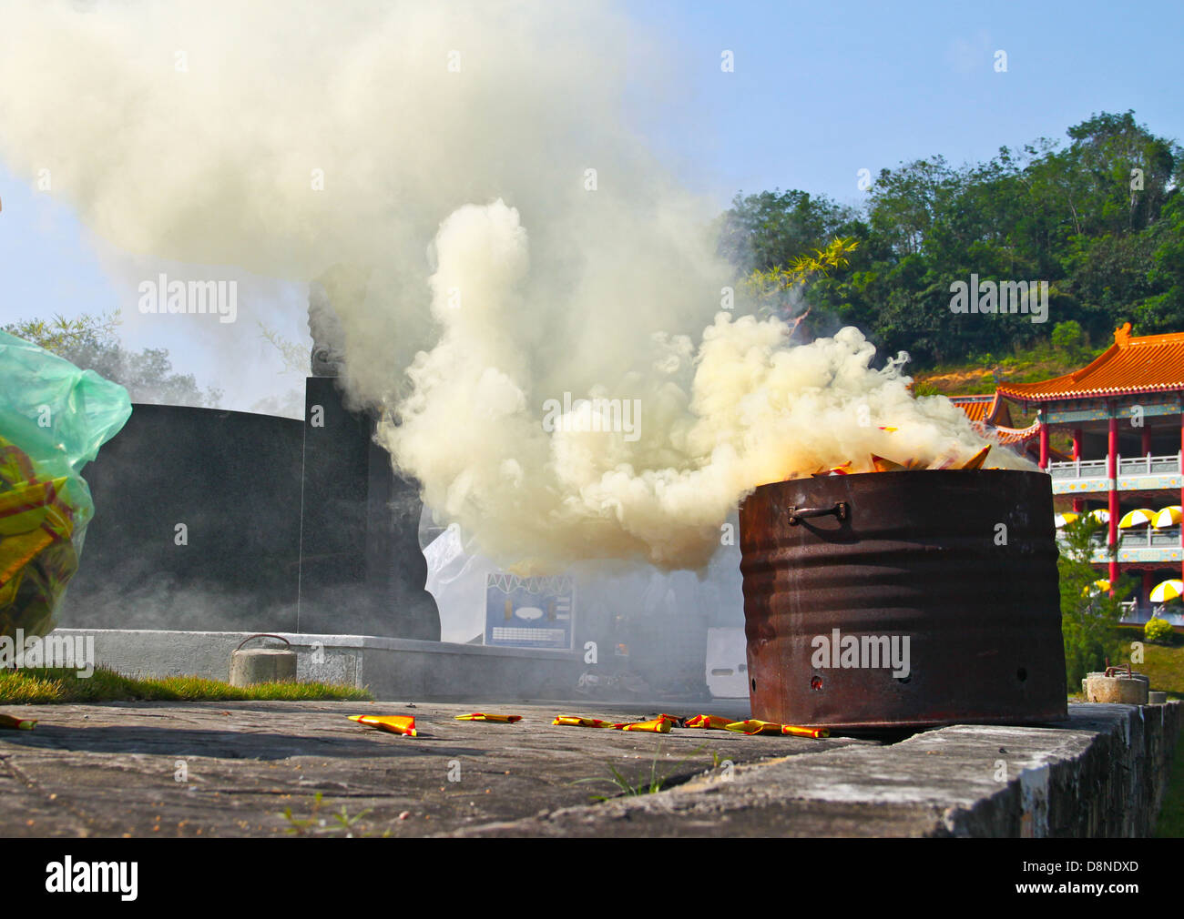 High concentration of poisonous smoke from incomplete burning of offerings. Environmental pollution from religion - Stock Image