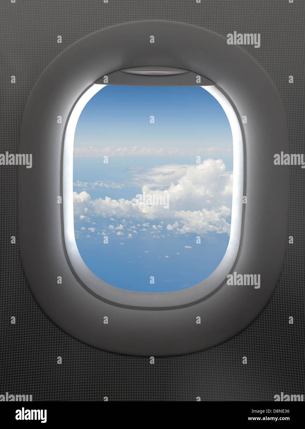 View through an airplane window, clouds - Stock Image