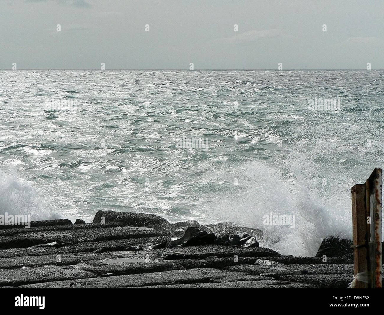 Wave breaking on oceans beach. - Stock Image