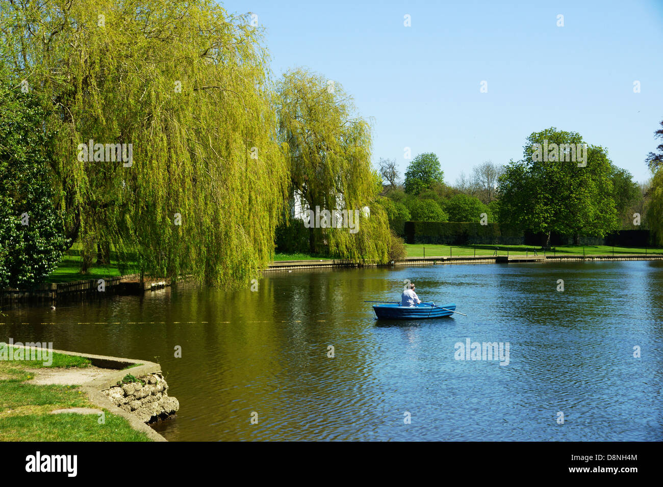 man enjoying rowing his boat on  the River Thames, Medmenham Stock Photo