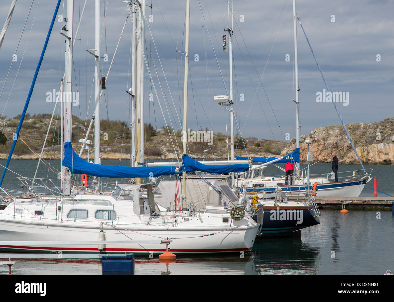 Sailboats in the Bratten harbor on Styrsö, an archipelago island near Gothenburg Sweden - Stock Image