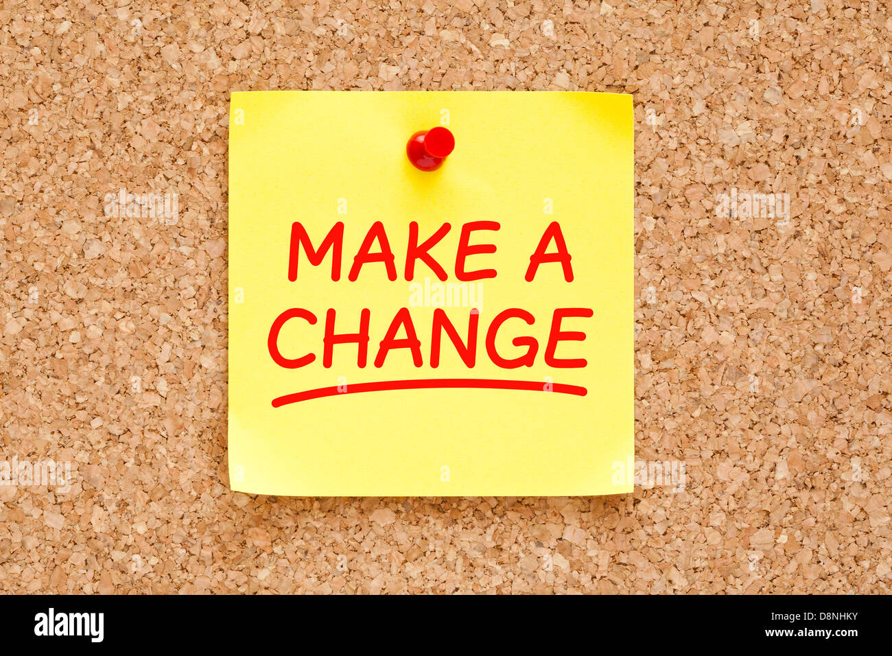 Make a Change written on yellow sticky note with red marker. - Stock Image