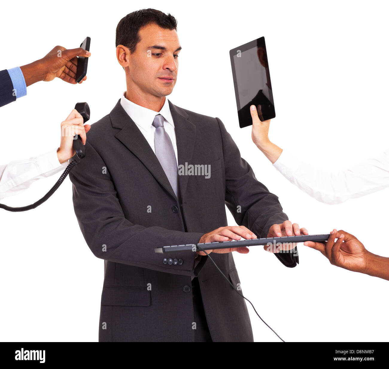 busy businessman working with multiple gadgets isolated on white - Stock Image