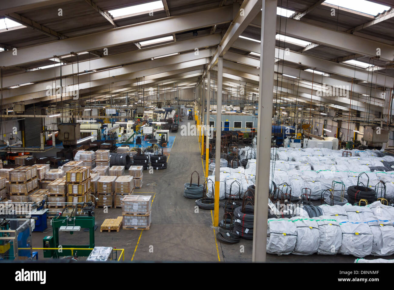 View inside of a British manufacturing plant or factory which specializes in the production of fasteners/nuts/bolts. - Stock Image