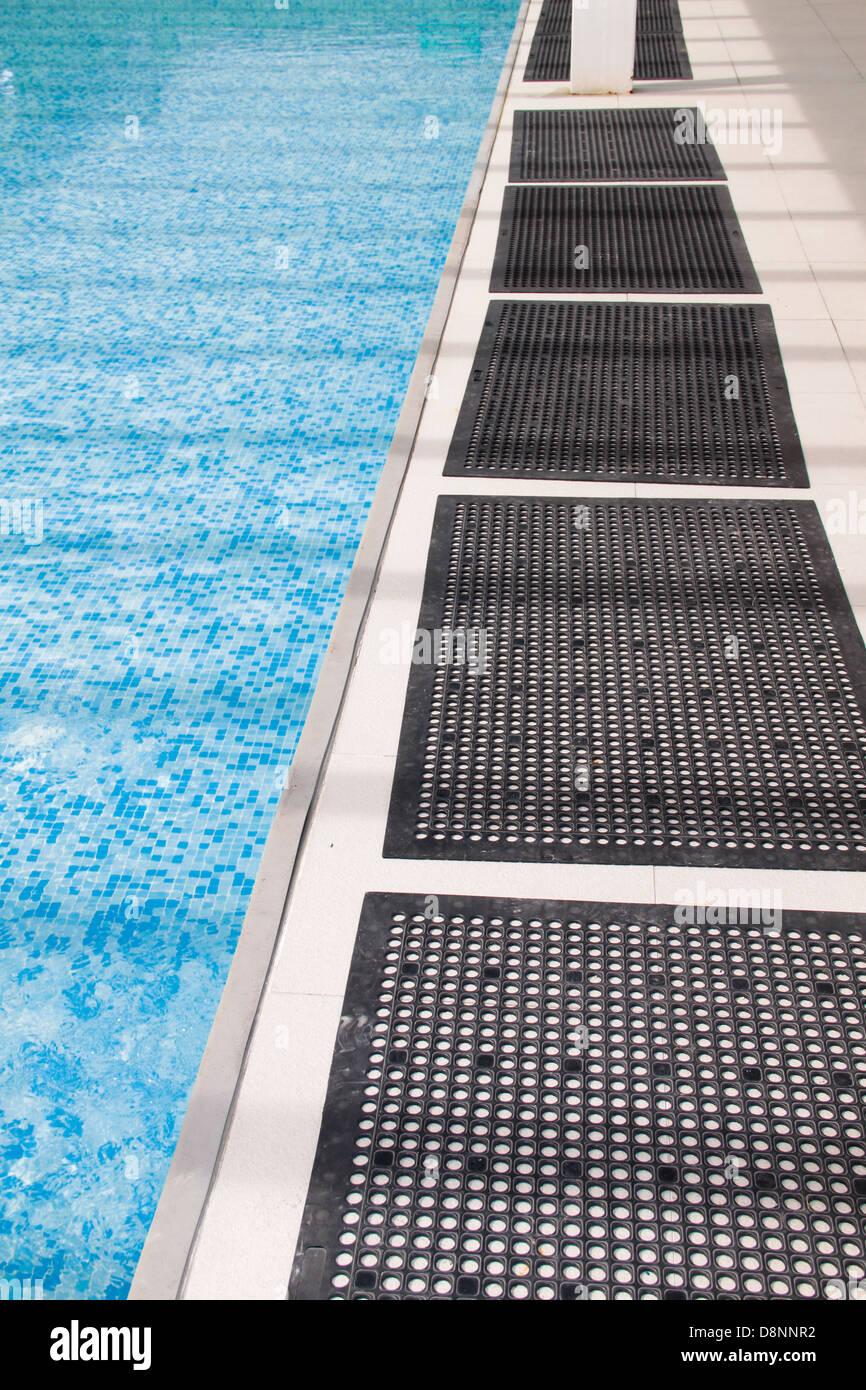 Anti-slip rubber mat beside children swimming pool. Concept of Stock ...