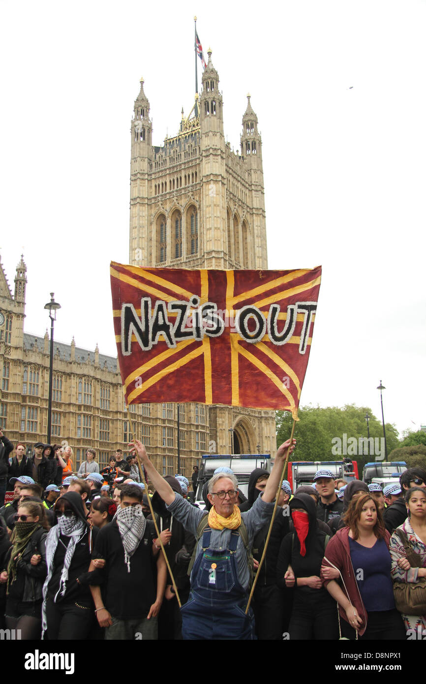 London, UK. 1st June, 2013. A United Against Fascism protester hold up a banner at the front of the blockade that Stock Photo