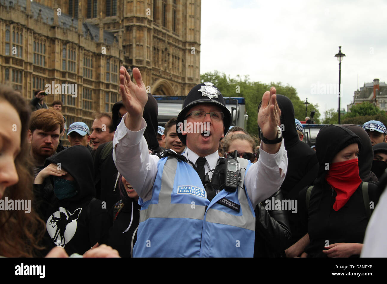 London, UK. 1st June, 2013. A police officer attempts to get the United Against Fascism supporters from blocking Stock Photo