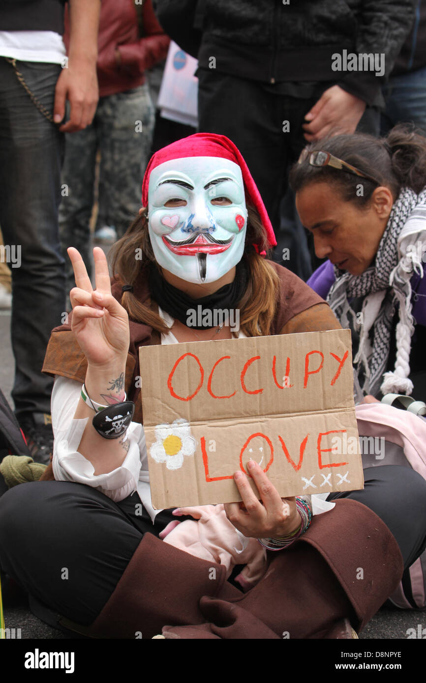 London, UK. 1st June, 2013. A United Against Fascism supporters with a anonymous mask seen during the stand off. Stock Photo