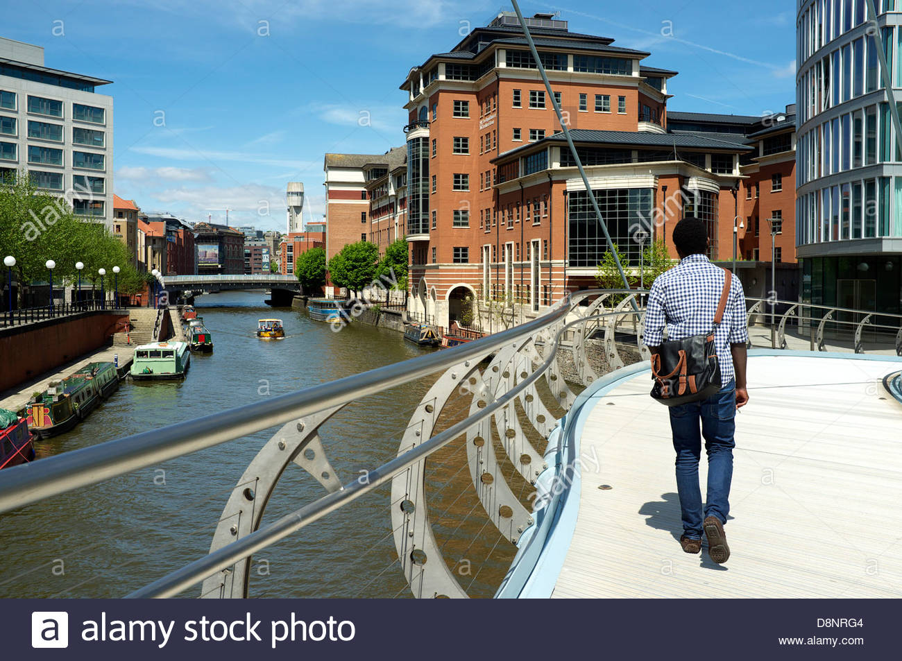 A view of the business area of Temple Quay and the River Avon in Bristol, UK. (the man is walking on Valentine's - Stock Image