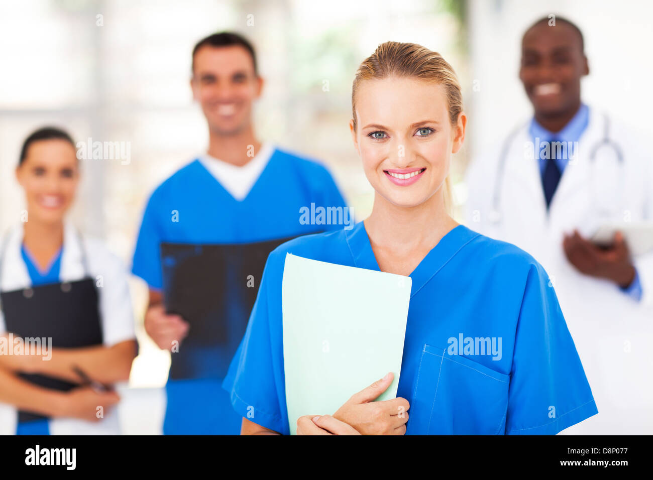 pretty medical nurse and colleagues in hospital Stock Photo