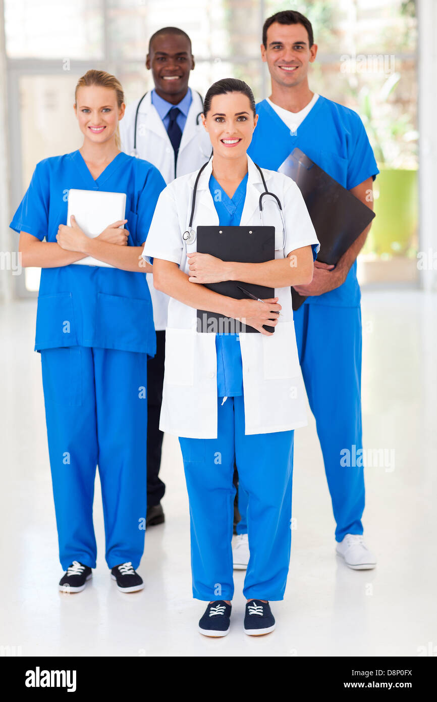 group of medical workers full length portrait in hospital - Stock Image
