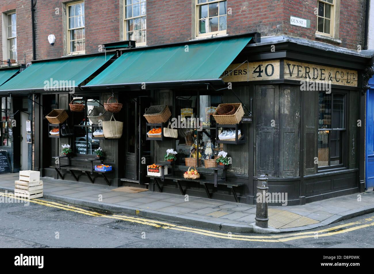 Old shop, Verde & Co. Ltd, delicatessen, opposite Spitalfields Market, East London, England, UK. - Stock Image