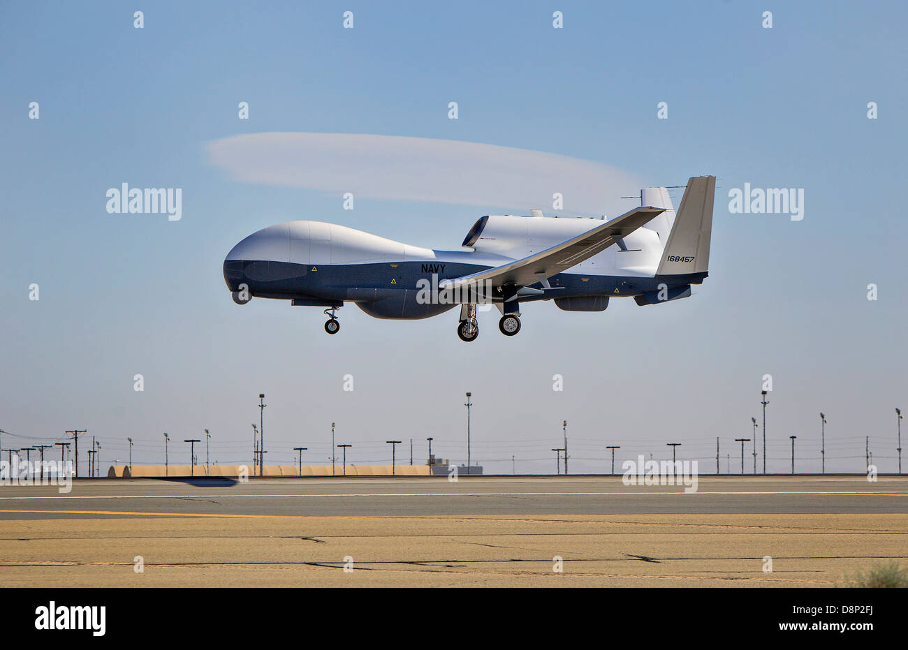 Northrop Grumman MQ-4C Triton unmanned aerial vehicle on the first flight test performs a landing April 22, 2013 Stock Photo