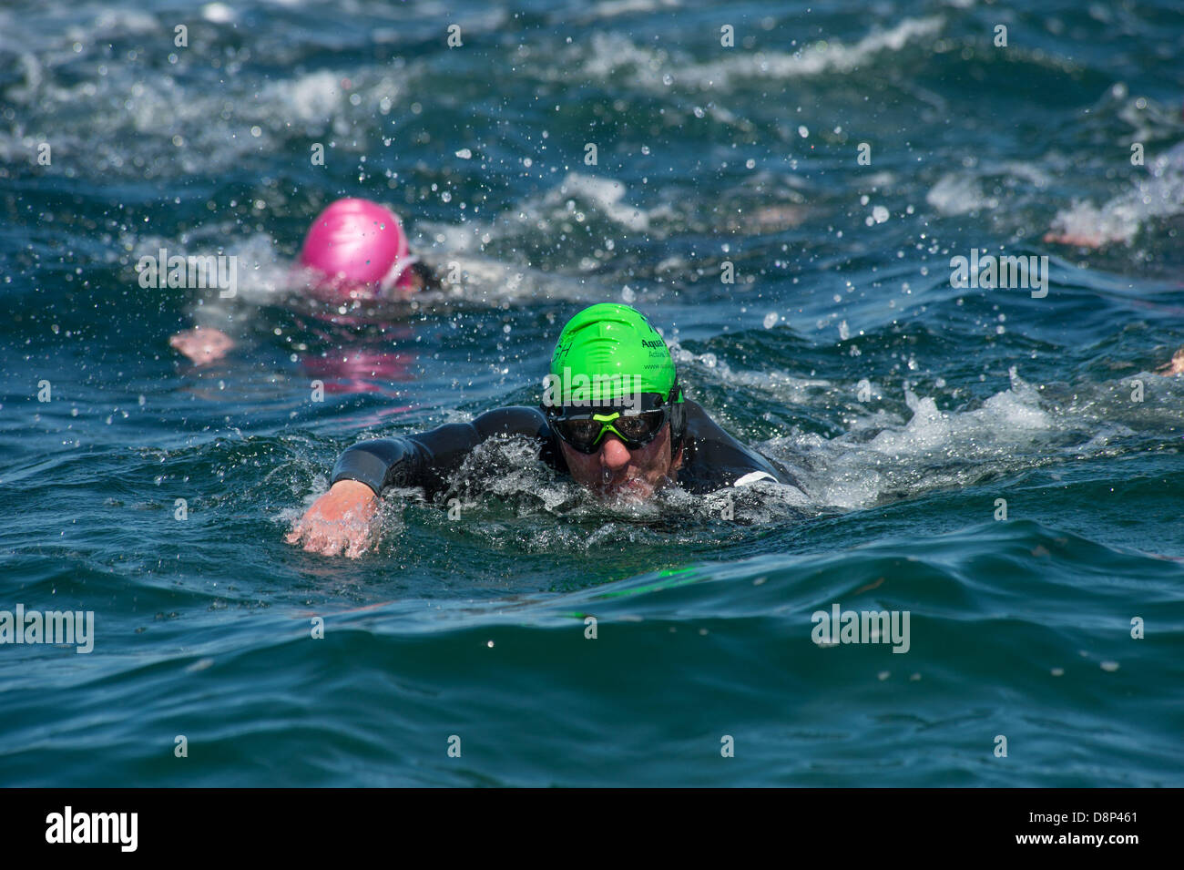 Aberystwyth, Wales, UK. 2 June 2013.   On a bright warm sunny summer's morning, members of Aberystwyth Triathlon - Stock Image