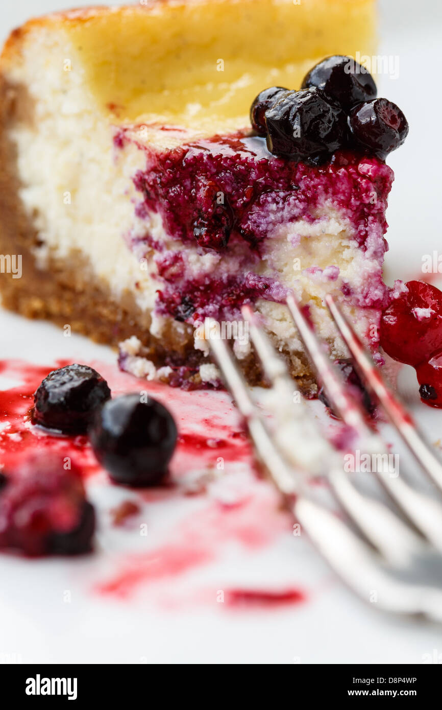 Cheesecake slice with mixed berries topping - Stock Image