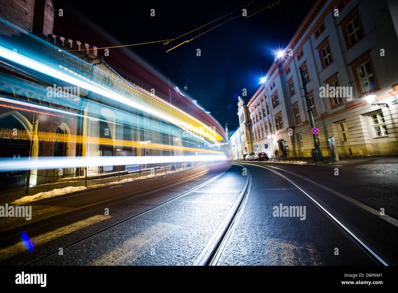 kraków street tram light long exposure night - Stock Image
