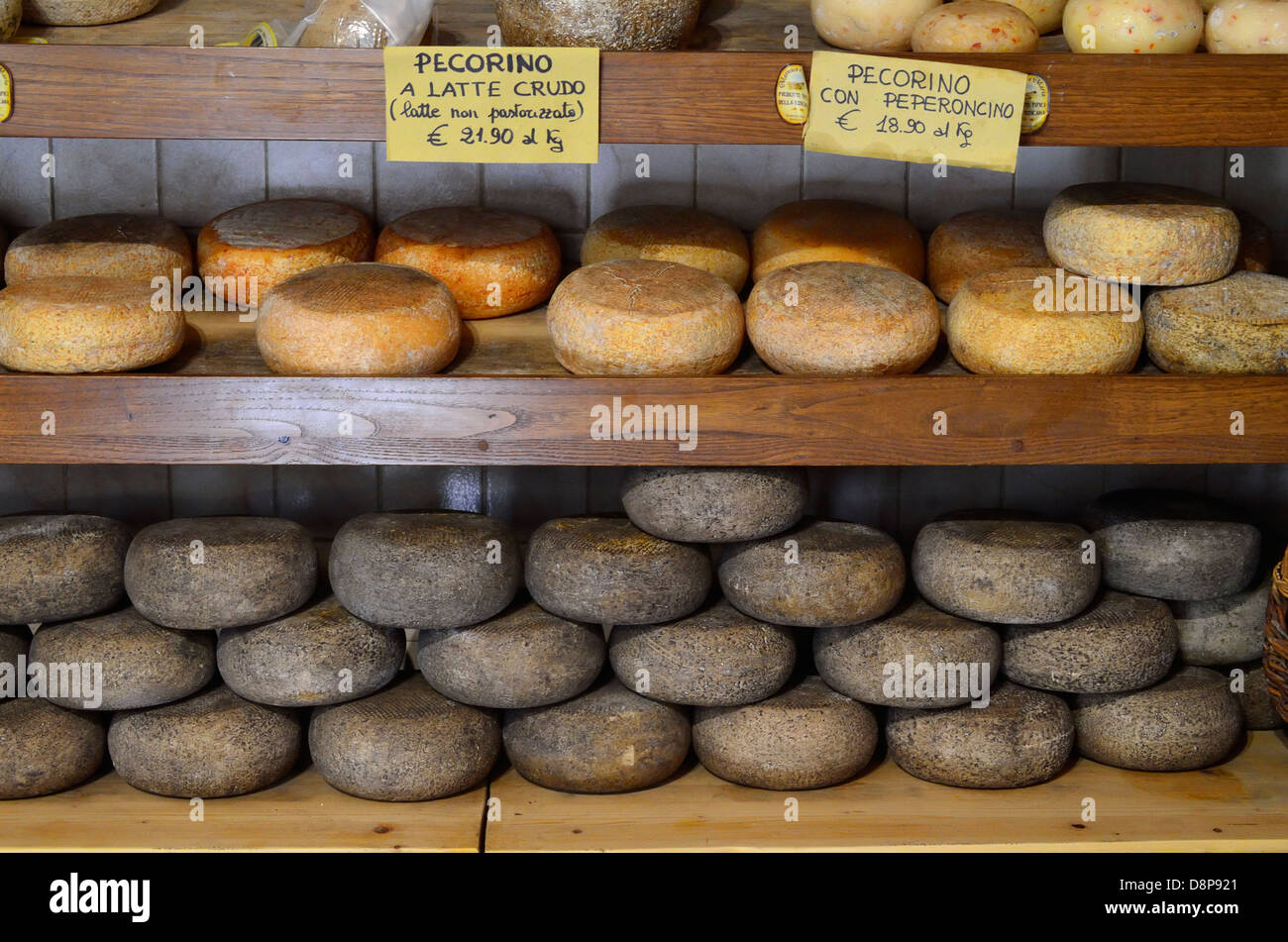Cheese on display at a shop in Pienza, Italy. - Stock Image