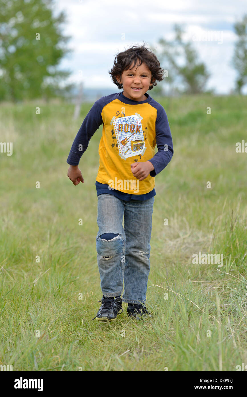 Young boy with torn pants, Wallowa Valley, Oregon. - Stock Image