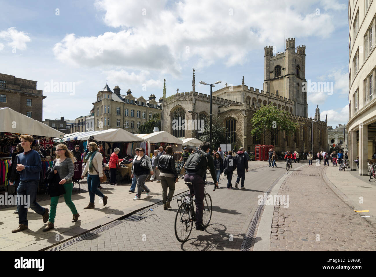 Busy street in Cambridge UK. Market, pedestrians and cyclist. Market street going into St Mary's Street. Great - Stock Image