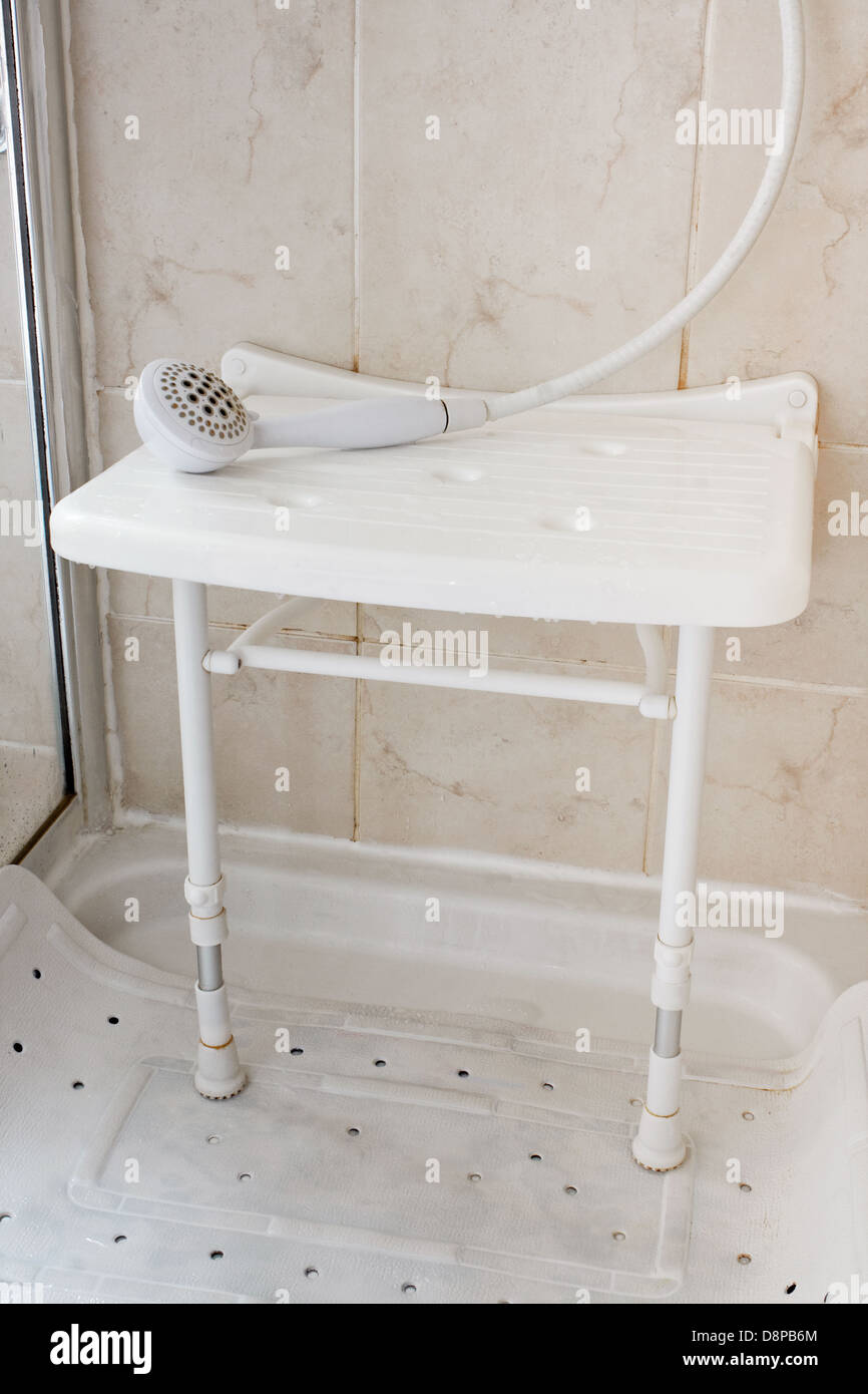 White plastic shower seat to enable disabled people to wash while sitting down - Stock Image