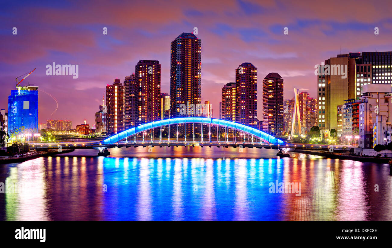 Tsukishima, Tokyo, Japan skyline crowded by residential high rises over the Sumida River. - Stock Image