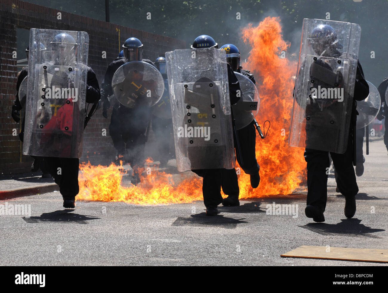 Hampshire, England, June 2013. Police undertake training against petrol bombs. Fire and flying glass. - Stock Image