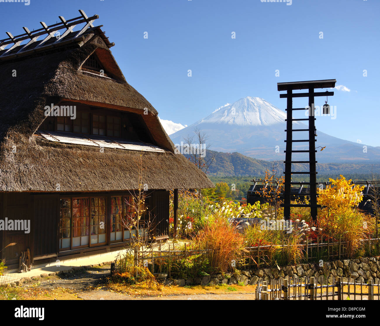 Historic Japanese huts in Kawaguchi, Japan with Mt Fuji Visible in the distance. - Stock Image