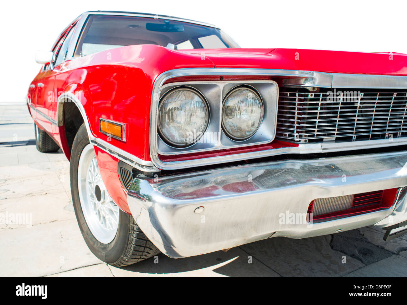 Old vintage retro car. Red color american car. White isolated - Stock Image