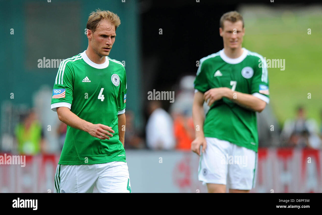 8fc42a697 Benedikt Höwedes (l) and Marcell Jansen of Germany react during the  international friendly soccer