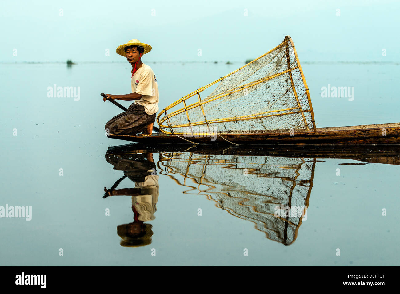 Fisherman fishing with net at Inle Lake Nyaungshwe Myanmar Burma - Stock Image