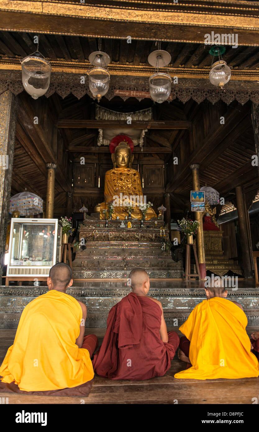 Buddhist monks preying at monastery near Mandalay Burma Myanmar - Stock Image
