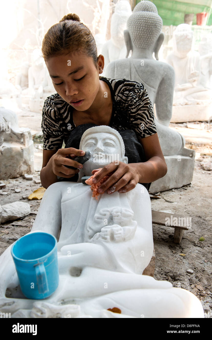 Burmese young woman crafting marble effigy of Buddha statue in the marble workshop district of Mandalay Burma Myanmar - Stock Image