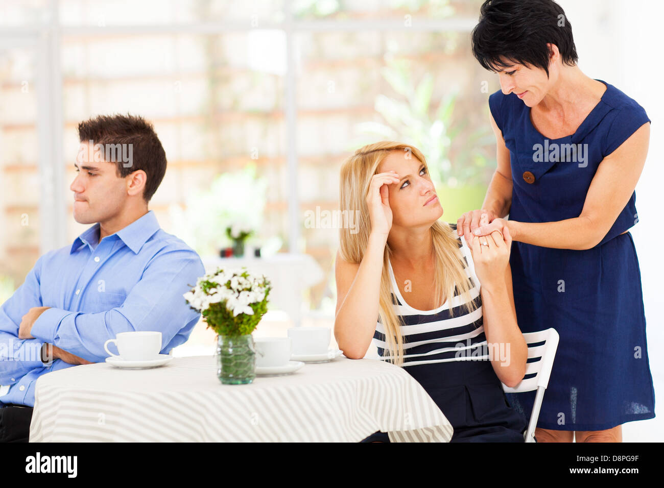 caring mother standing by her daughter when she has marriage problem - Stock Image