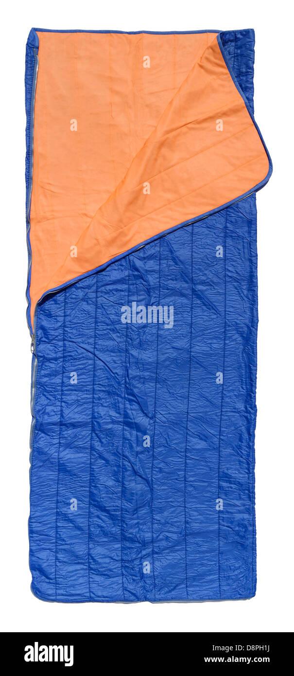 Blue sleeping bag with orange lining - Stock Image