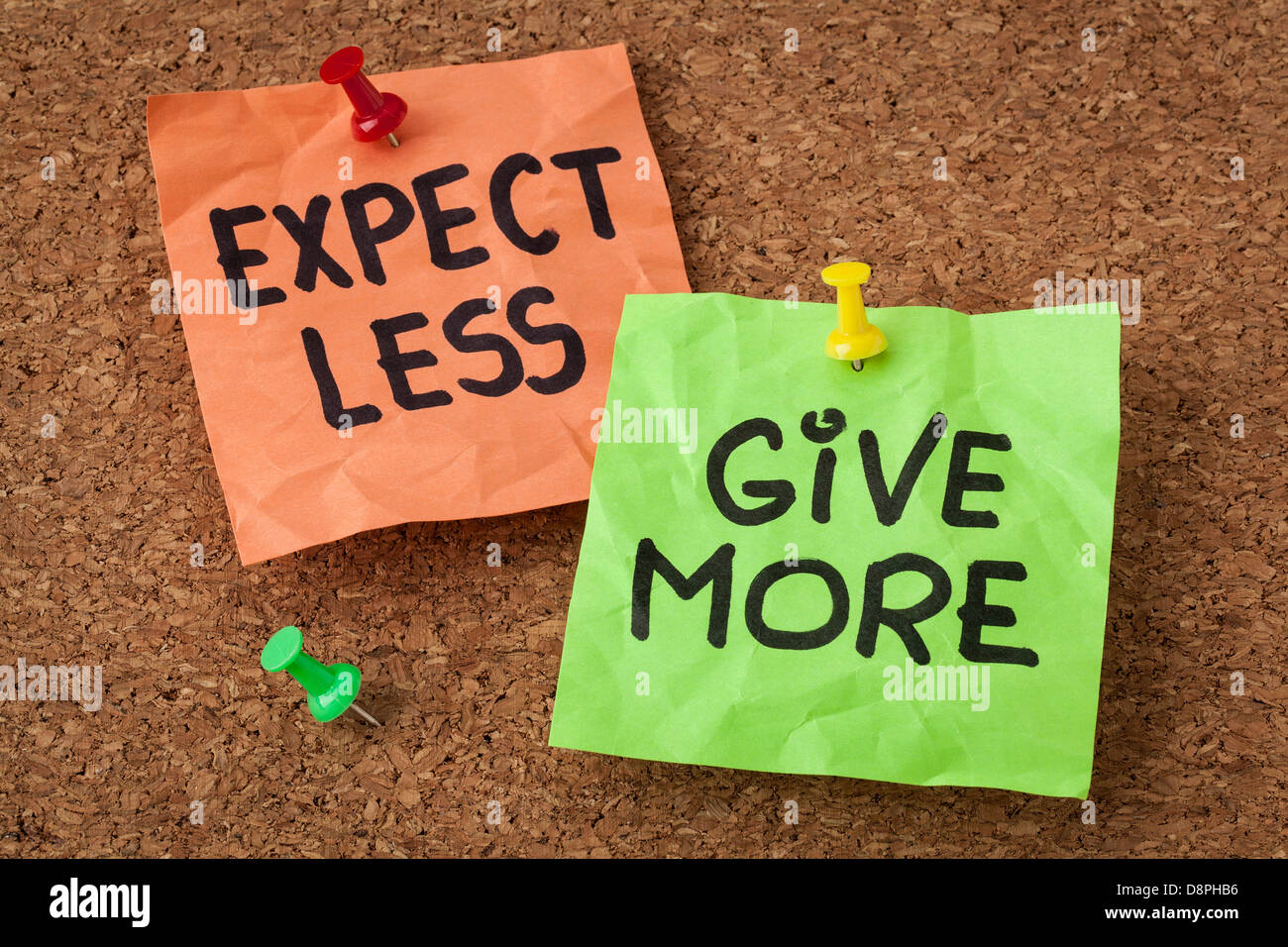 expect less, give more - motivation or self improvement concept - handwriting on colorful sticky notes - Stock Image