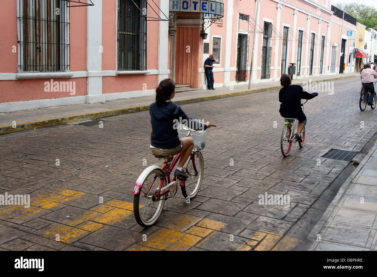 People riding bicycles during Sunday bici ruta on Calle 60 in Merida, Yucatan, Mexico - Stock Image