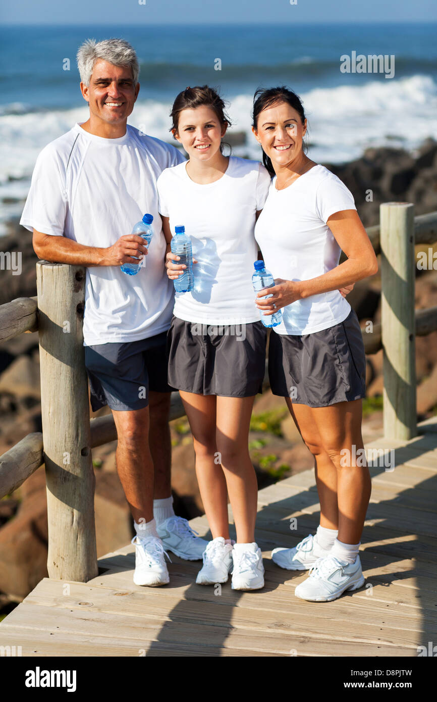 beautiful healthy family at the beach after exercise - Stock Image