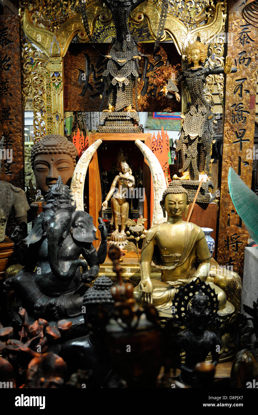 Asian art and artifacts gathered in a shrine like display - Stock Image