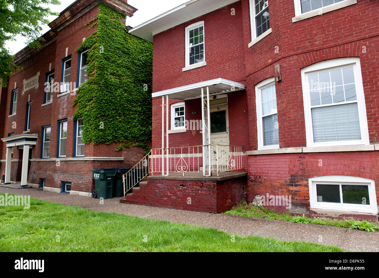 Photo Of A Row Of Old, Run Down Brick Apartment Buildings