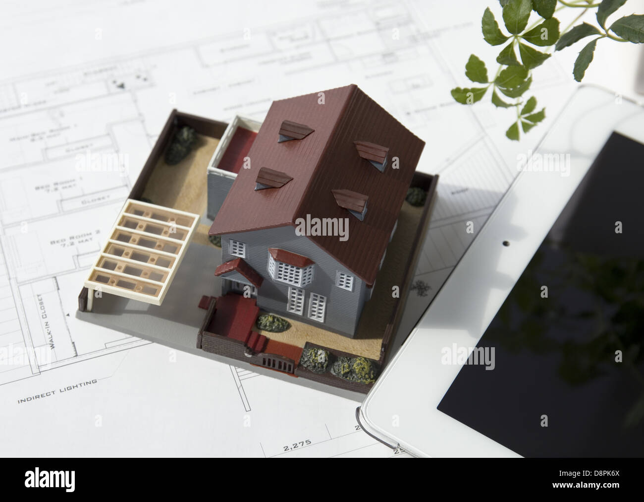Architectural drawing, an architectural model and a tablet PC - Stock Image