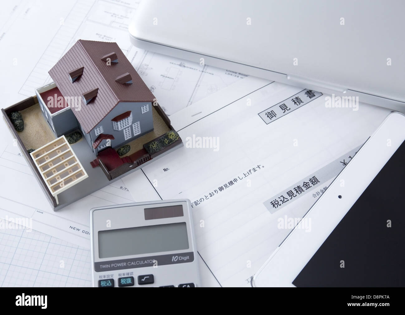 Estimate and an architectural model - Stock Image