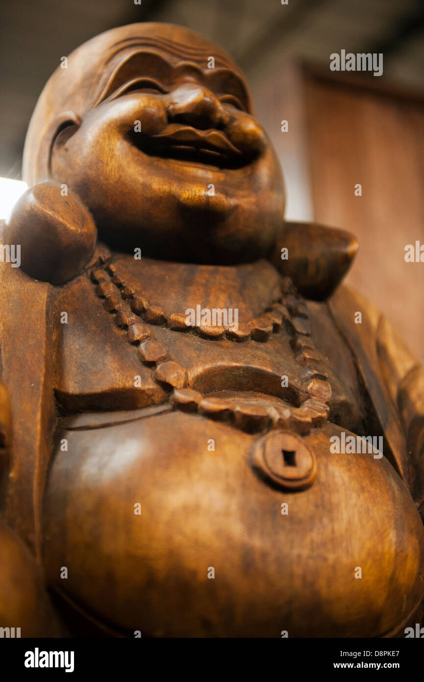 A Wooden Buddha Statue With Big Belly Stock Photo Alamy