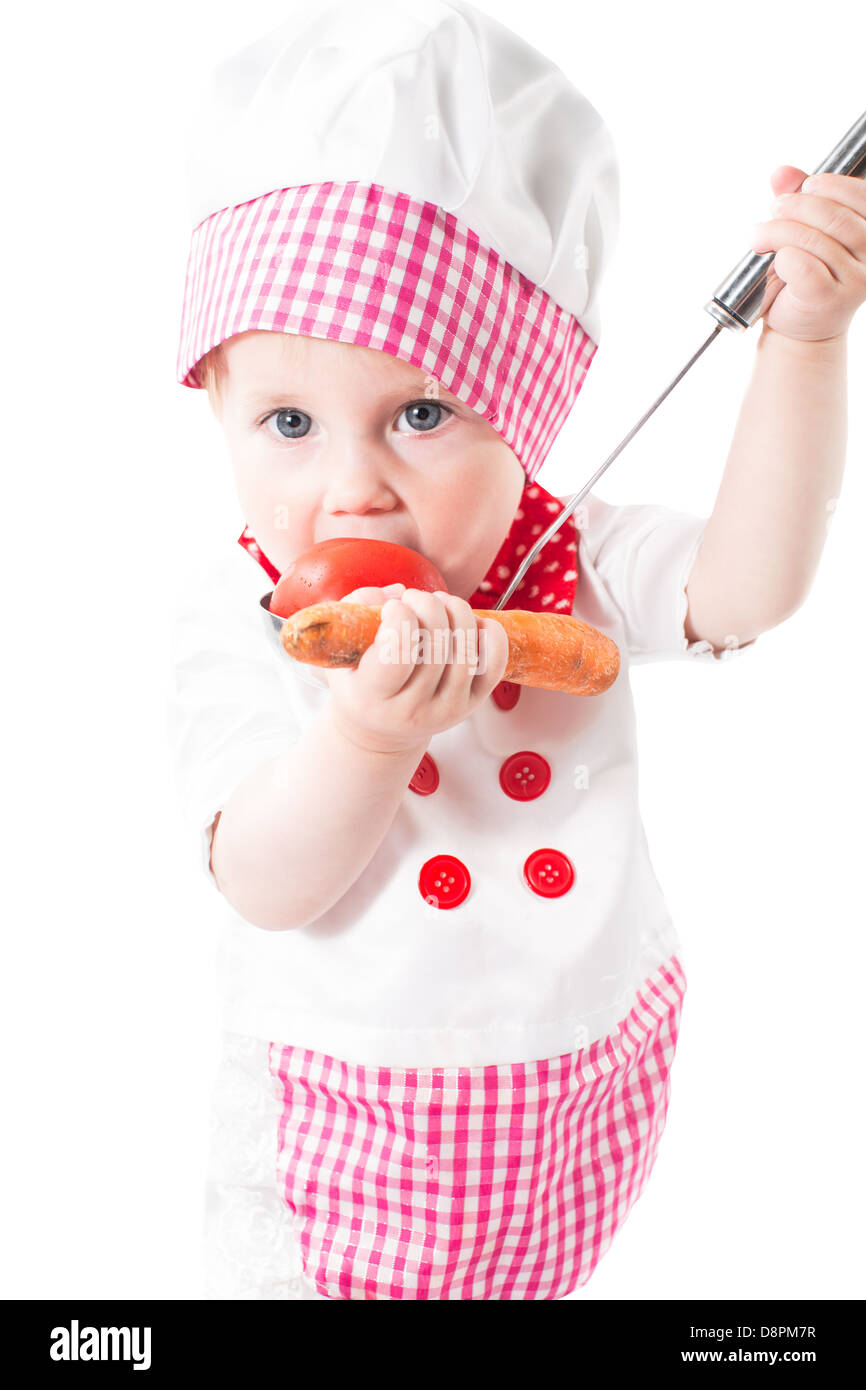 7cf26b6b5ea Baby girl cook wearing a chef hat with vegetables and pan isolated on white  background.The concept of healthy food and childhood