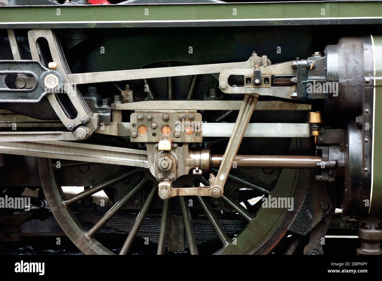 Close up of  steam train engine wheel and piston - Stock Image