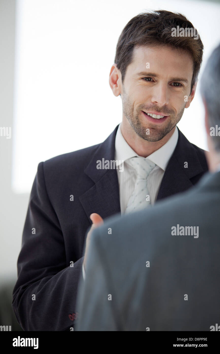 Businessman talking with colleague - Stock Image
