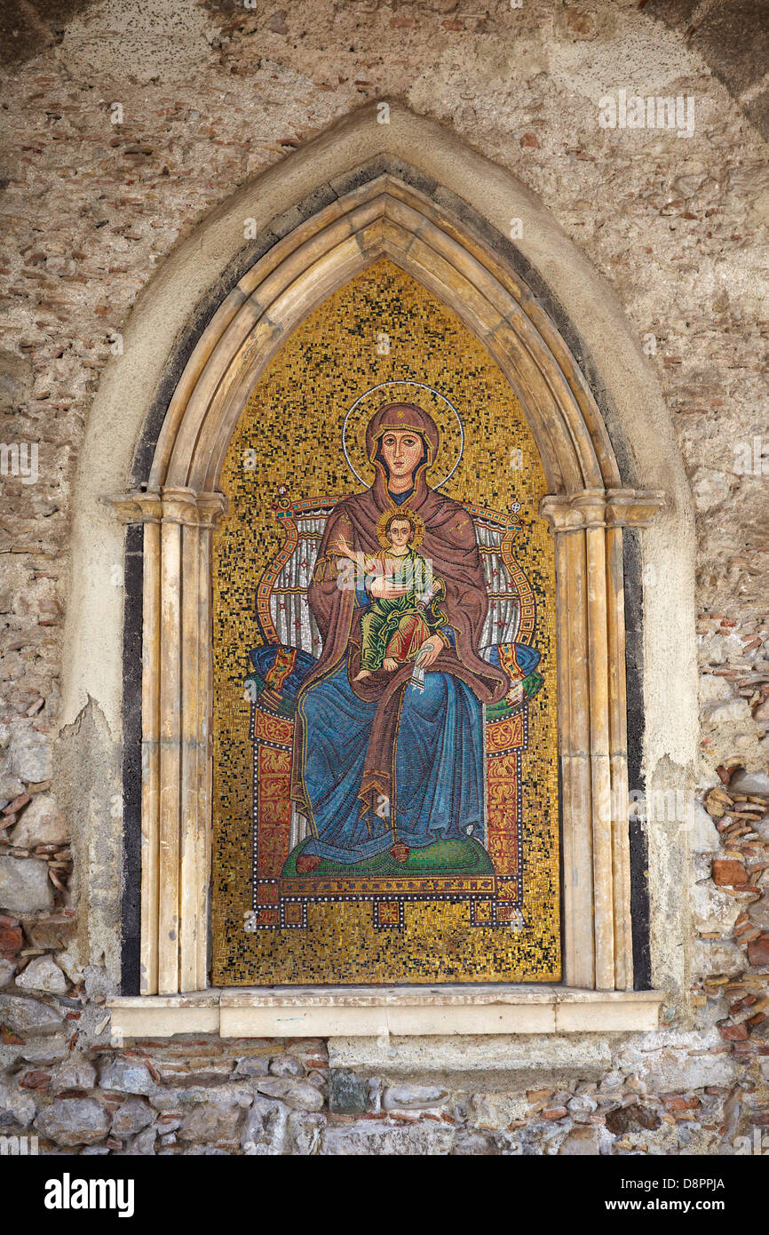 Religion mosaic of Mary and Jesus on wall of Torre dell' Orologio, Taormina, Sicily, Italy - Stock Image