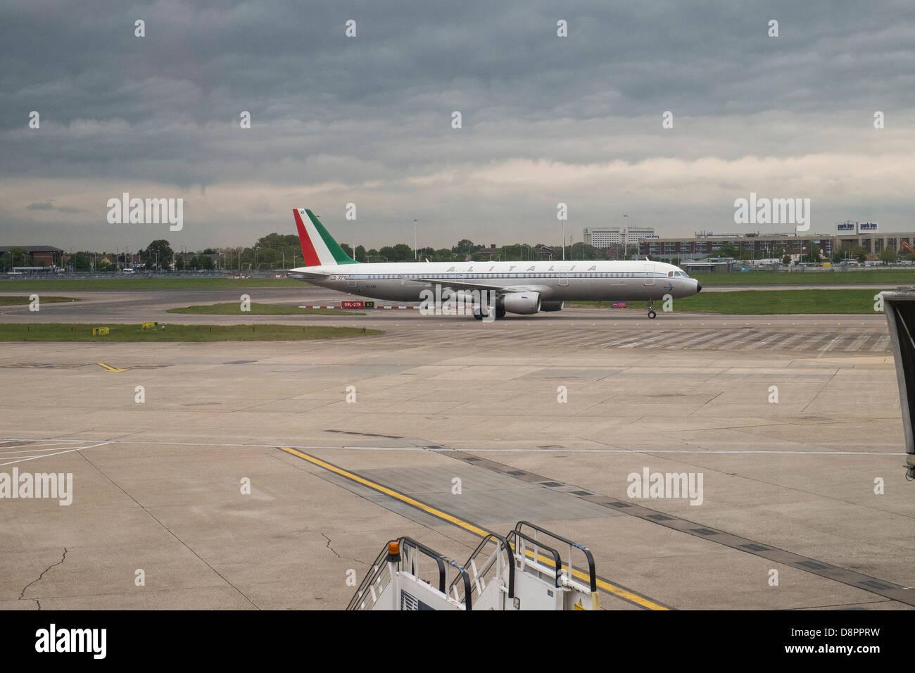 alitalia plane on runway - Stock Image