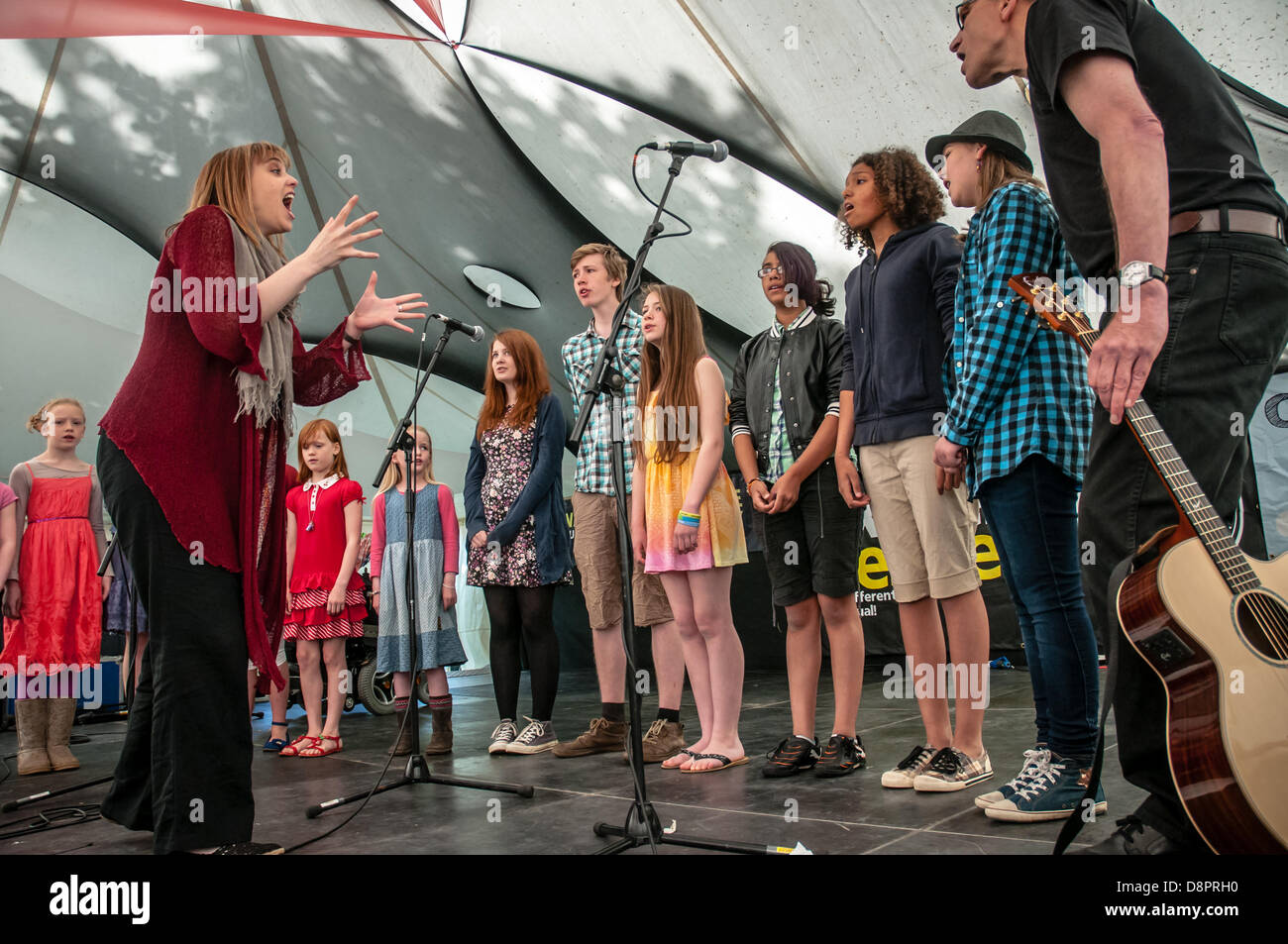 Wren Music's Singing Roots Choir performing at the Exeter Respect Festival 2013 in Belmont Park Exeter, UK - Stock Image