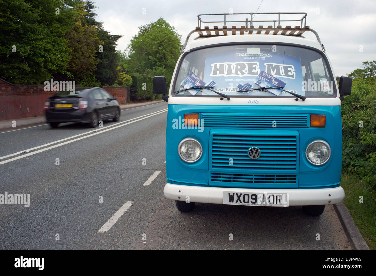 VW camper van to hire parked beside the A12 trunk road, Suffolk, UK. - Stock Image