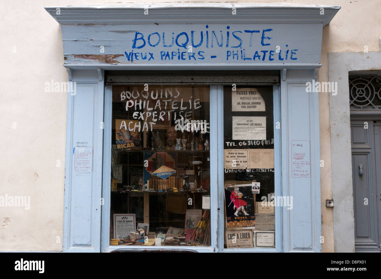 A small secondhand bookshop in Beziers selling old papers, stamps and curios. Stock Photo